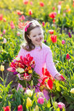 Little girl in tulip flower garden Royalty Free Stock Image