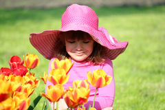 Little girl and tulip flowers Royalty Free Stock Photo