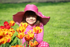 Little girl with tulip flowers portrait Royalty Free Stock Photo