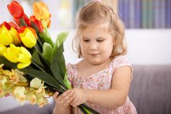 Little girl with tulips Stock Image