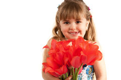Little girl with tulips bouquet Stock Photography
