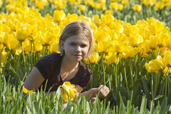 Little girl in tulips field Royalty Free Stock Images