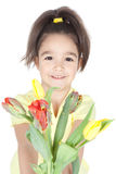 Little girl with tulips on white Royalty Free Stock Images