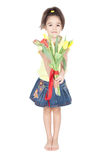 Little girl with tulips on white Stock Photography