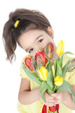 Little girl with tulips on white Royalty Free Stock Photography