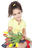 Little girl with tulips on white Stock Images