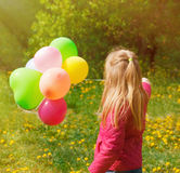 Little  girl Turned back with balloons Royalty Free Stock Images