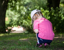 Little girl turning back Stock Photography