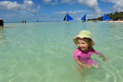 Little girl in the turquoise ocean Royalty Free Stock Image