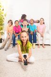 Little girl with TV remote control Stock Images