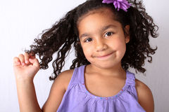Little girl twirling her hair Stock Images