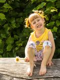 Little girl is twisted, Funny face. Shows teeth royalty free stock images