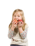 Little girl with two apples Stock Photography