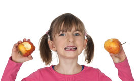 Little girl with two apples Royalty Free Stock Images