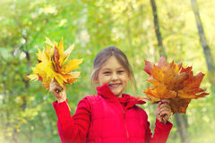 Little girl with two bouquets Stock Image