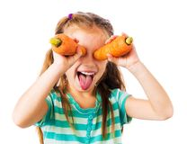 Little girl with two carrots Stock Photo