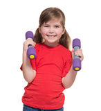 Little girl with two dumbbells Stock Photos