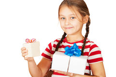 Little girl with two gifts Royalty Free Stock Photo