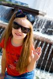Little girl in two glasses. Smiling little girl in two glasses near the fountain Stock Photography