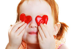 Little girl with two little red heart Stock Photos