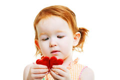 Little girl with two little red heart Stock Images