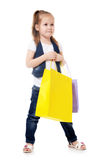 The little girl with two packages Royalty Free Stock Photo