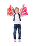 The little girl with two packages Royalty Free Stock Photos