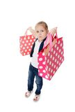 The little girl with two packages Stock Images