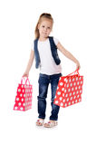 The little girl with two packages isolated stock photos