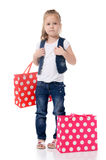 The little girl with two packages isolated royalty free stock photos
