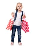 The little girl with two packages isolated Royalty Free Stock Image