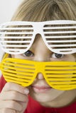 little girl in  two pairs of white and yellow sun Stock Photography