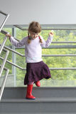 Little girl with two pigtails holding railing Stock Photography