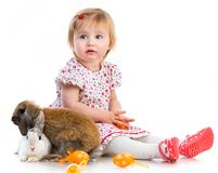 Little girl  with two rabbits Royalty Free Stock Photography