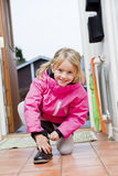 Little Girl tying her shoes Royalty Free Stock Images