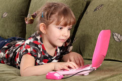 Little girl typing on laptop Royalty Free Stock Photos