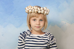 Little girl with Ukrainian traditional wattled garlic round Royalty Free Stock Image