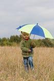 Little girl with umbrella Stock Image
