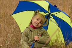 Little girl with umbrella. Little girl with her umbrella in autumn day Stock Image