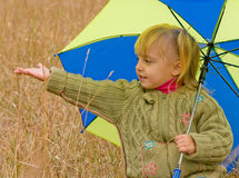 Little girl with umbrella. Little girl with her umbrella in autumn day Royalty Free Stock Images