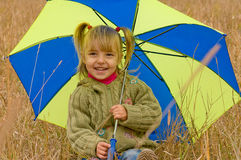 Little girl with umbrella. Little girl with her umbrella in autumn day Royalty Free Stock Image