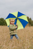 Little girl with umbrella. Little girl with her umbrella in autumn day Stock Photo