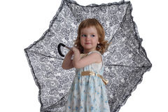 Little girl with umbrella. Isolated on white background Stock Photo