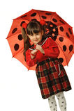 The little girl with a umbrella. It is isolated on a white background Royalty Free Stock Images