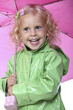 Little girl with umbrella Stock Photos