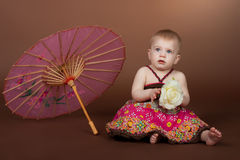 A little girl with an umbrella Stock Image