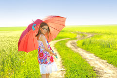 A little girl with a umbrella Royalty Free Stock Photos