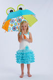 Little girl with umbrella. A little girl with a colorful frog umbrella Stock Images