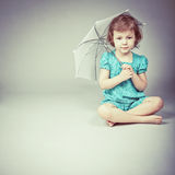 Little girl with  umbrella. Beauty a little girl with umbrella Royalty Free Stock Image