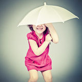 Little girl with umbrella. Funny little girl with umbrella Royalty Free Stock Photo